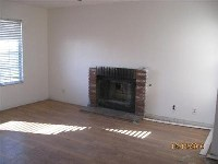 Wood floors and a fireplace on a nice size lot
